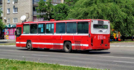 Kazakhstan, Ust-Kamenogorsk, july 8, 2019: Scania CN112CL. Red old bus on one of the city streets. Old bus. Scania bus. Red scania