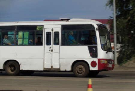 Kazakhstan, Ust-Kamenogorsk, june 7, 2019: Small city bus on one of the city streets. Public transport. Motion