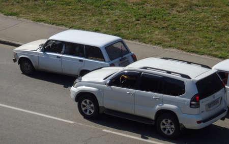 Kazakhstan, Ust-Kamenogorsk, August 11, 2019; Traffic top view. One of the city streets. Vaz 2104 and Toyota Land Cruiser Prado 120