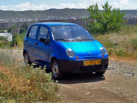Kazakhstan, Ust-Kamenogorsk, july 8, 2019: Daewoo Matiz (aka Chevrolet Spark) first generation. Blue car. Landscape