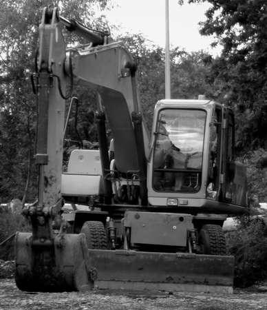 Excavator black and white. Construction equipment. Excavator closeup