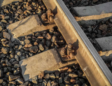 Steel rails and concrete sleepers in the stones on the railway. Fragment of railroad tracks. Railway background