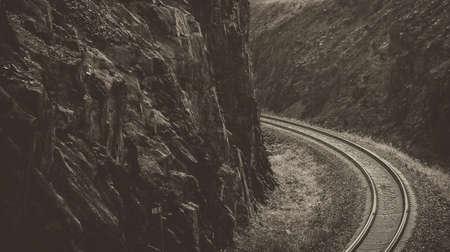 Railway between the rocks. Monochrome. Kazakhstan (Ust-Kamenogorsk). Outskirts 写真素材