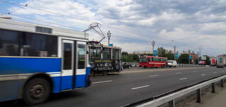 Kazakhstan, Ust-kamenogorsk, July 5, 2017: Movement of traffic along the Ulba bridge. City traffic. Urban landscape. Cityscape. Bridge over Ulba river