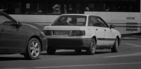Kazakhstan, Ust-Kamenogorsk, june 14, 2018: Audi 80 B3 on one of the city streets. Black and white photo