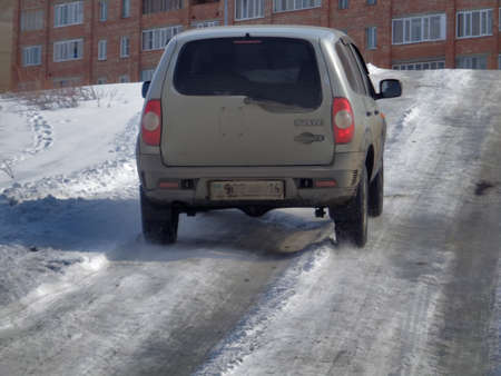 Kazakhstan, Ust-Kamenogorsk, march 17, 2018: A car Chevrolet Niva on country road. Snow Road