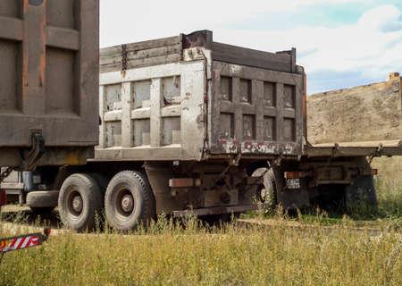 Kazakhstan, Ust-Kamenogorsk, august 18, 2017: Trucks Shakman and Kamaz rear view
