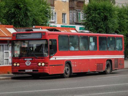 Kazakhstan, Ust-Kamenogorsk, july 16, 2018: Red Scania CR113 (SL). Red city bus