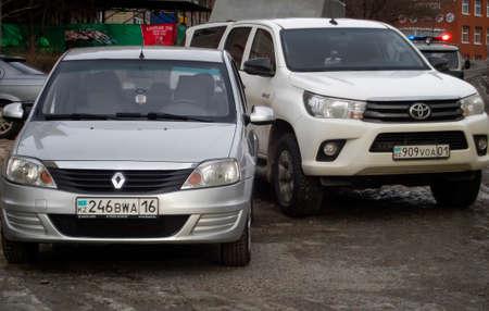 Kazakhstan, Ust-Kamenogorsk, november 27, 2018: Toyota HiLux and Renault Logan. Two cars