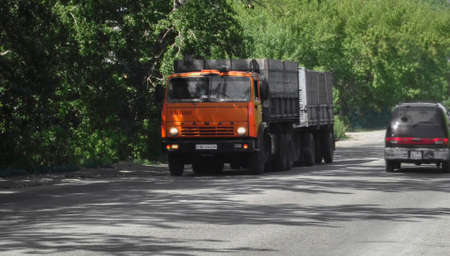 Kazakhstan, Ust-Kamenogorsk, june 1, 2018: Kamaz 5320 on the city street. Orange truck 報道画像