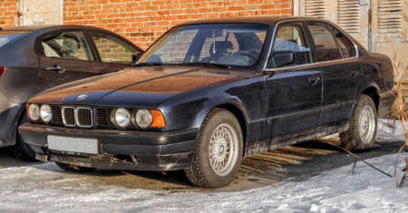 Kazakhstan, Ust-Kamenogorsk, january 29, 2018: Bmw E34 5 - series in the city street. Old German car 報道画像