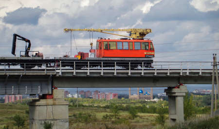 Kazakhstan, Ust-Kamenogorsk, september 9, 2018: Railcar on railroad bridge. Urban landscape 報道画像