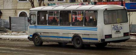 Kazakhstan, Ust-Kamenogorsk, november 27, 2018: Urban bus PAZ 32051 in the city street. Public transport. Passenger transportation. Commercial vehicles. Urban grunge