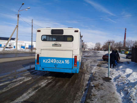 Kazakhstan, Ust-Kamenogorsk, march 9, 2018: City bus on one of the streets of the city. City outskirts. Scania bus 報道画像