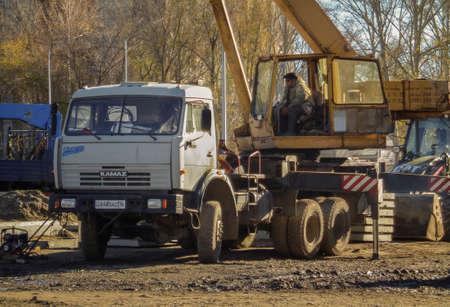 Kazakhstan, Ust-Kamenogorsk, october 24, 2018: Crane operator at work. Truck crane on KAMAZ. Construction site