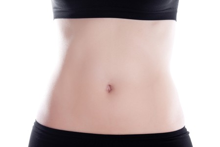 Womans belly isolated on white.