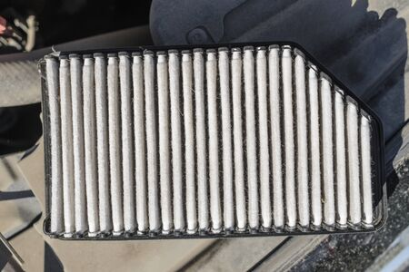 Dirty old passenger car engine air filter - top view