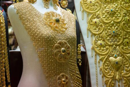 Dubai gold market, showcase with jewelry and yellow gold mannequin