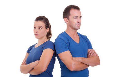 upset couple, back to back , isolated on white, studio shot photo