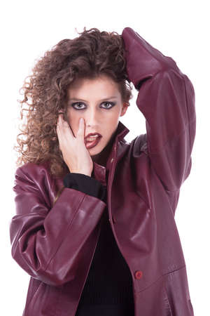 beautiful woman, with curly hair holding her hair, with with his tongue out and a winter coat, isolated on white background, studio shot Stock Photo - 16251054