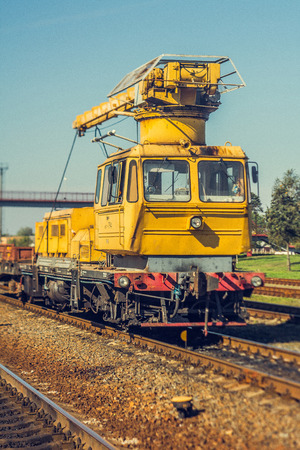 Old railway crane, track repair Stock Photo
