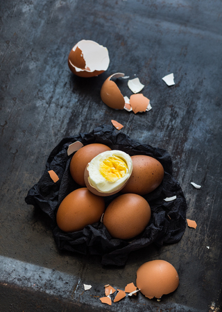 Brown eggs on a black napkin on dark background 版權商用圖片