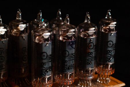 Nixie tubes IN-16 on a printed circuit board with electronic components Stock Photo