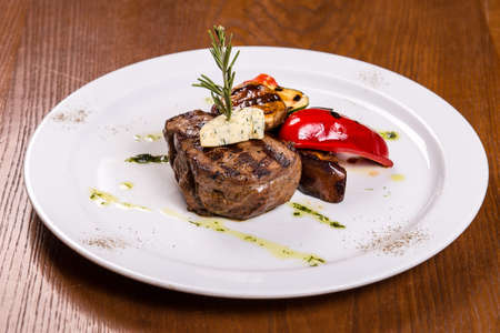 grille: Beef fillet steak with red pepper on white platew Stock Photo