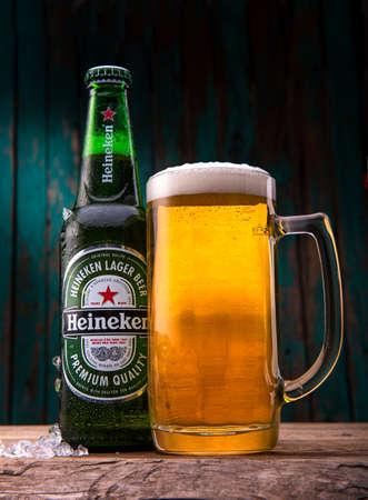 MINSK, BELARUS - JANUARY 05, 2017: Bottle of Heineken Lager Beer with glass on wooden table. Heineken is the flagship product of Heineken International.