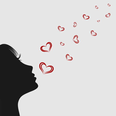 Girl blowing on hearts. Silhouette. Air kiss
