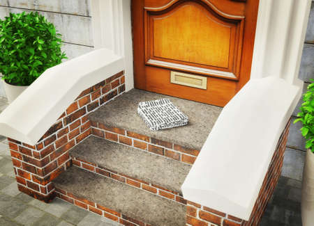 lately newspaper on a stairs near door. photo