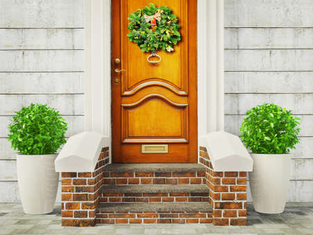 welcome door: vintage door with a decoration christmas garland.