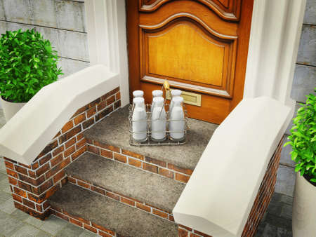 old wooden door: milk in bottles stay on a stairs near door.   Stock Photo
