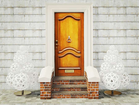 vintage door and two decoration fir-tree near wall Stock Photo - 11712330