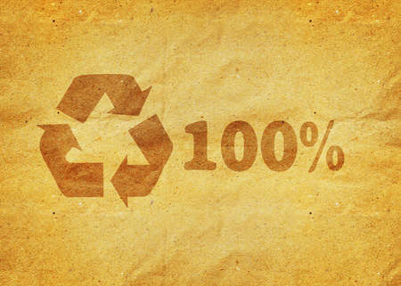 biodegradable: recycle symbol  on a yellow vintage  paper