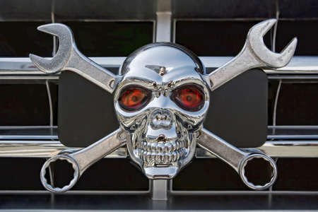 Wrench and  Skull icon on a grille car photo