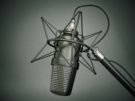 music production: studio microphone isolated on a dark  background