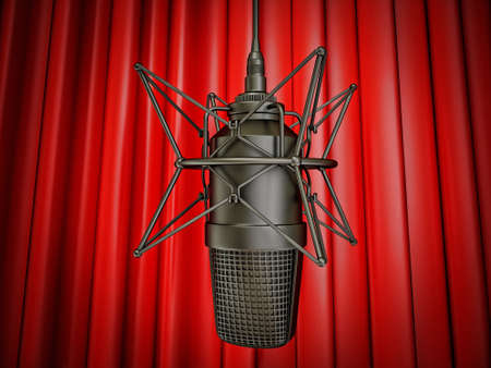music production: studio microphone isolated on a red background