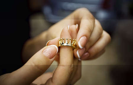 gold jewelry: gold ring on a fingers.   Stock Photo