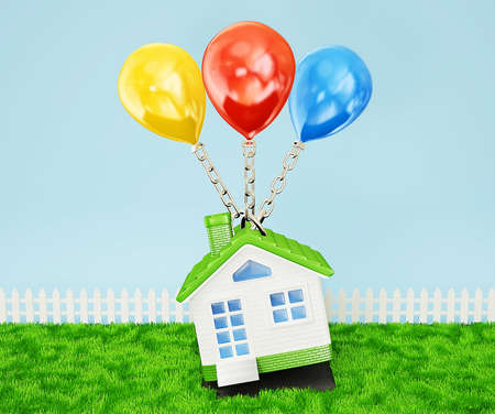 somewhere: green house with a colored balloon fly somewhere Stock Photo