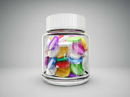 medicine box: colored pills in bottle isolated on a grey background Stock Photo
