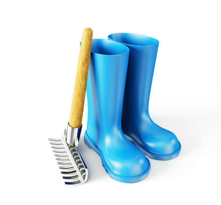 wellingtons: blue wellingtons and rake isolated on a white Stock Photo