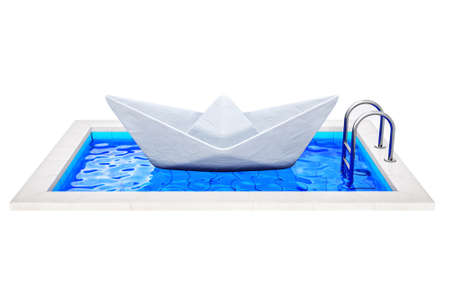 poolside: papper ship in a swimming pool isolated