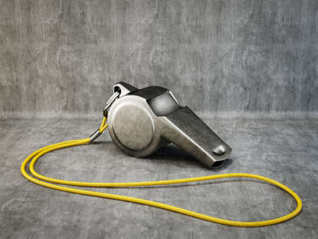 information technology law: metal whistle isolated on a grey background