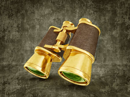 gold  binoculars isolated on a dirty  background photo