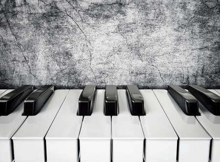 black piano: black and white piano keys on a stucco wall