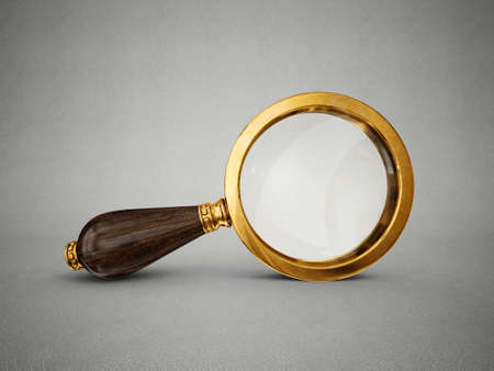 old magnifier isolated on a grey background Stock Photo
