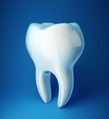 carious: white tooth isolated on a blue background Stock Photo