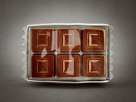milk chocolate in a transparent wrapperon  grey photo