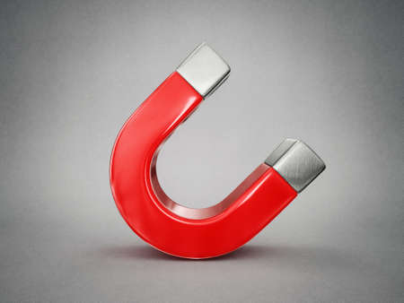 magnetic north: red magnet isolated on a grey background Stock Photo